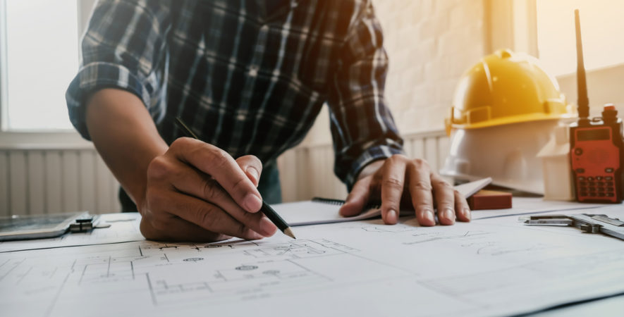 Male,architect,or,engineer,working,at,home,drawing,the,construction